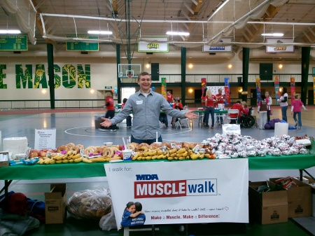 Michael Toner cheers on walkers at the MDA Muscle Walk