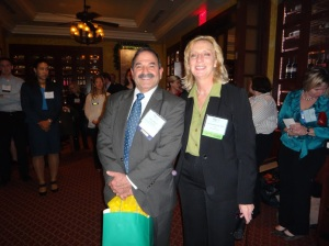 Danny Selnick with PRSA-NCC president Suzanne Holroyd at the chapter holiday party. (Photo courtesy of PRSA-NCC.)