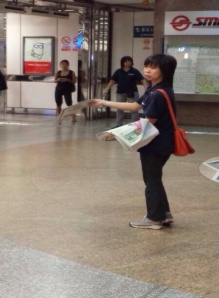 """""""TODAY lady"""" at MRT station"""