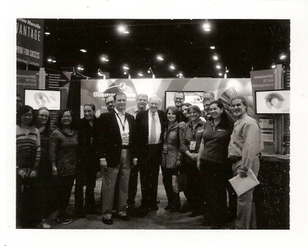 Business Wire Team with warren Buffett at the 2014 Berkshire Hathaway Shareholders Meeting. Photo credit Matthew Allinson